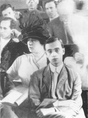 Leo Frank in the courtroom; his wife Lucille Frank behind him