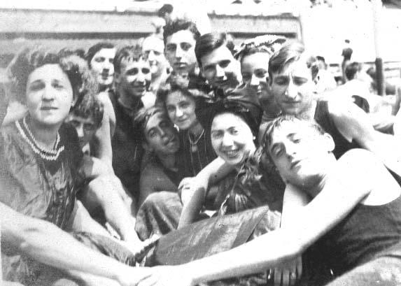 A young Leo Frank (top center) and friends enjoy a day at the beach in New York.